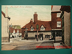 Colourised postcard view of the Eight Bells pub