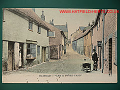 Colourised postcard view of the Arm and Sword yard